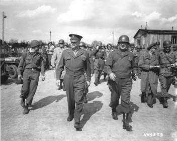 General Dwight D. Eisenhower and General Troy Middleton, commanding general of the XVIII Corps, Third US Army, tour the newly liberated Ohrdruf concentration camp. Ohrdruf, Germany, April 12, 1945. — National Archives and Records Administration, College Park, Md.